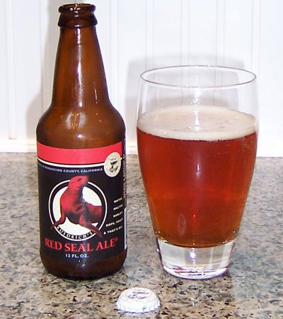 Bottle and fresh glass of North Coast Brewing Red Seal Ale