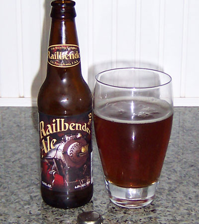 Bottle and fresh glass of Erie Brewing Company Railbender Ale