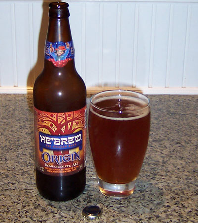 Bottle and fresh glass of He'Brew (Shmaltz Brewing) Origin Pomegranate Ale