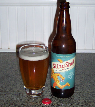 Bottle and fresh glass of MacTarnahans Brewing Co. (Portland Brewing) SlingShot Extra Pale Ale