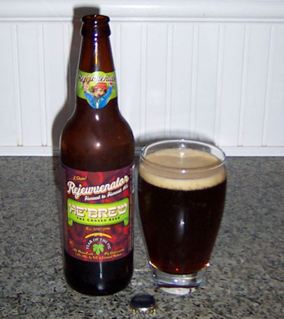 Bottle and fresh glass of Shmaltz Brewing Company Rejewvenator