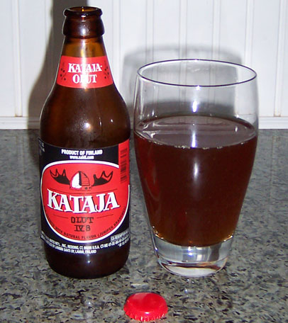 Bottle and fresh glass of Lammin Sahti Oy Kataja Olut