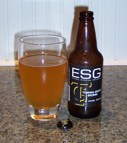Bottle and fresh glass of Terminal Gravity ESG (Extra Special Golden_