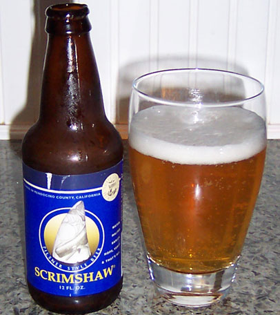 Bottle and fresh glass of North Coast Brewing Scrimshaw