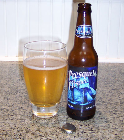 Bottle and fresh glass of Erie Brewing Company Presque Isle Pilsner