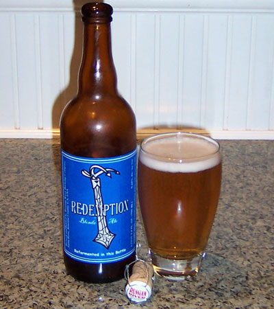 Bottle and fresh glass of Russian River Brewing Redemption