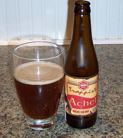 Bottle and fresh glass of Brouwerij der St.Benedictusabdij de Achelse 2006 Trappist Achel