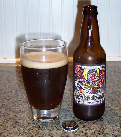 Bottle and fresh glass of Baird Brewing Angry Boy Brown