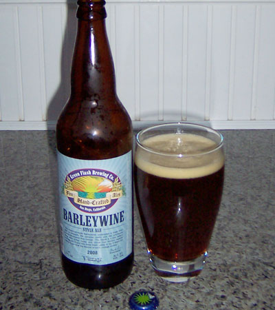 Bottle and fresh glass of Green Flash Brewing 2008 Barleywine